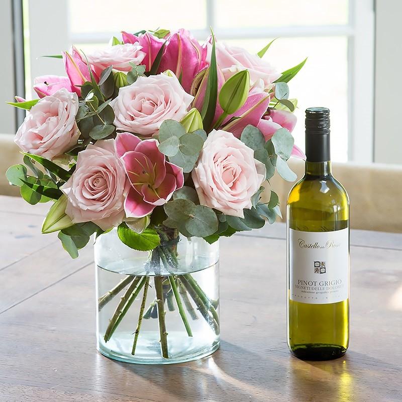 Flower Arrangements In Wine Bottles: Wine & Mixed Flowers In A Vase